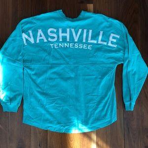 NASHVILLE woman's LS shirt.